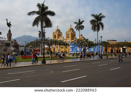 TRUJILLO, PERU - SEPTEMBER 1, 2014: Colourful Spanish colonial style buildings around the Plaza de Armas in the centre of Trujillo in northern Peru. - stock photo