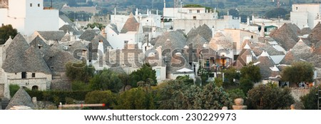 Trulli, the typical old houses in Alberobello in Puglia, Italy. - stock photo