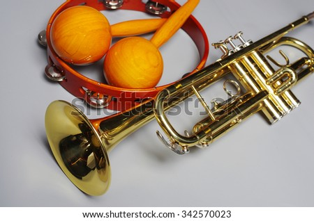 Trumpet, maracas and tambourine. - stock photo