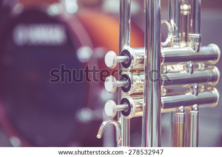 Trumpet on drum background - stock photo