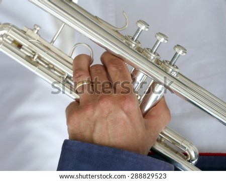 trumpeter with the trumpet in his hand - stock photo