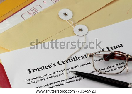 Trust certificate with pen and manila envelop - stock photo