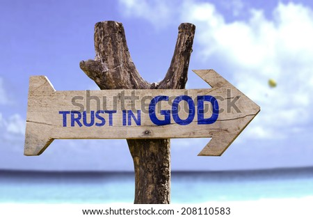 Trust in God wooden sign with a beach on background  - stock photo