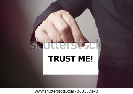 TRUST ME message on the card , business concept , business idea - stock photo