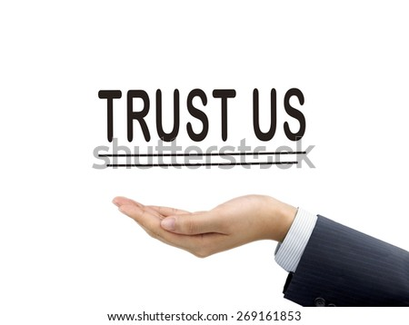 trust us words holding by businessman's hand over white background - stock photo