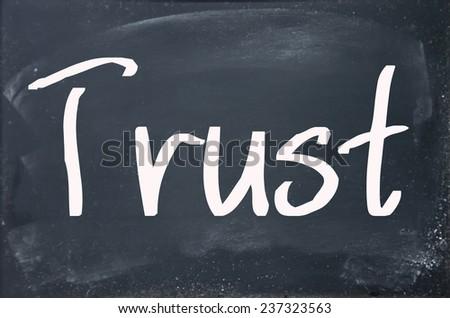 trust word on blackboard - stock photo