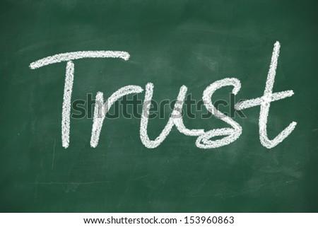 trust written with chalk on a blackboard - stock photo