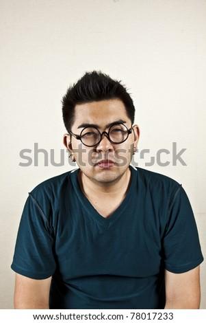 Try focus, A man wearing eyeglass, narrow eyes. - stock photo