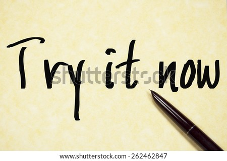 try it now text write on paper  - stock photo