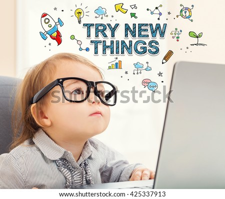 Try New Things concept with toddler girl using her laptop - stock photo