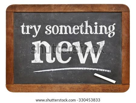 Try something new  - advice on a vintage slate blackboard - stock photo