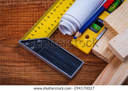 Try square pencil blueprints wooden studs construction level on vintage wood board maintenance concept. - stock photo