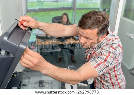 Trying to repair the office printer - stock photo