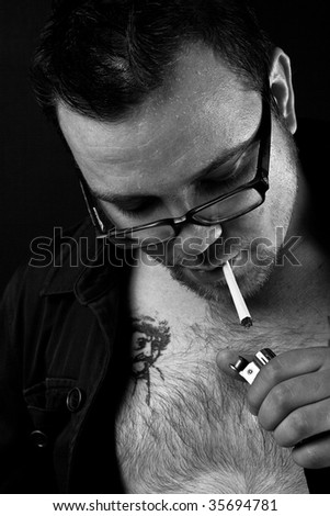 Trying to smoke with lighter - stock photo