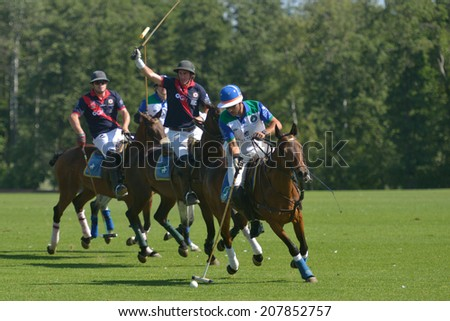 TSELEEVO, MOSCOW REGION, RUSSIA - JULY 26, 2014: Match British Schools - Moscow Polo Club during the British Polo Day. Moscow Polo Club won 7-6 - stock photo