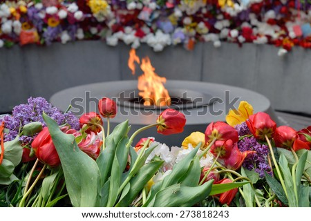 Tsitsernakaberd, The Armenian Genocide memorial complex. The eternal flame at the center of the twelve slabs. Yerevan, Armenia - stock photo