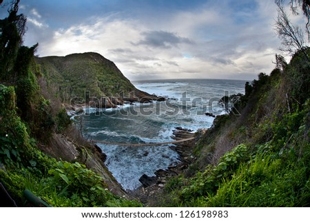 Tsitsikamma National Park is on South Africa's Garden Route and has a spectacular coastline that begs to be explored. - stock photo