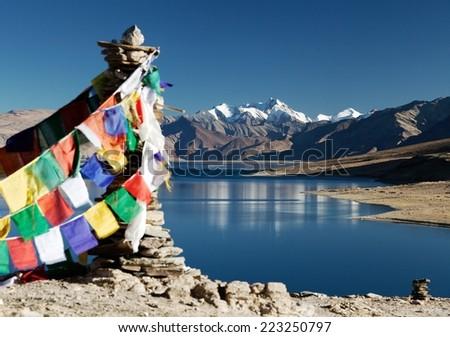 Tso Moriri Lake with prayer flags - Ladakh - Jammu and Kashmir - India  - stock photo