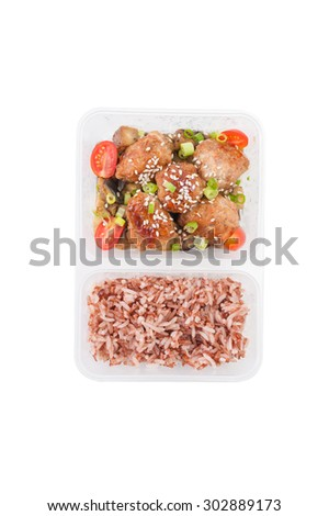 Tsukune (Japanese chicken meatballs) cooked by clean food concept with brown rice in lunch box on white table isolated on white background - stock photo