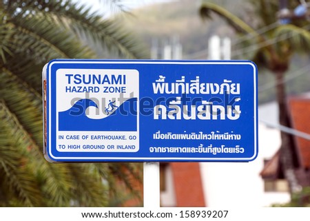 Tsunami danger sign in Phuket, Thailand - stock photo