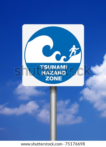Tsunami warning blue signs on blue sky background - stock photo