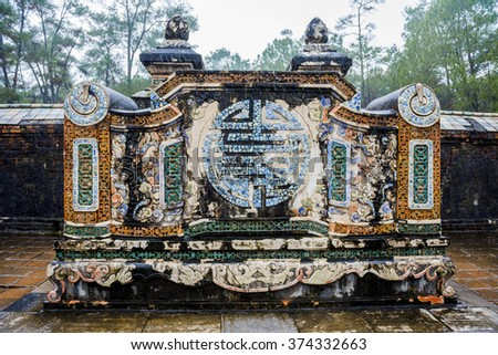 Tu Duc Mausoleum Mosaic Spirit Screen decorated with  glazed ceramics, porcelain mosaic and fresco painting, Vietnam with the Chinese Four Blessings good luck symbol - stock photo