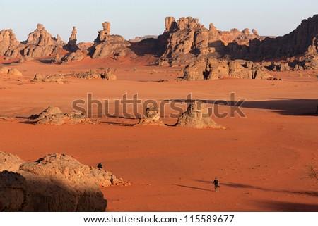 Tuareg and sand dunes in the desert - stock photo