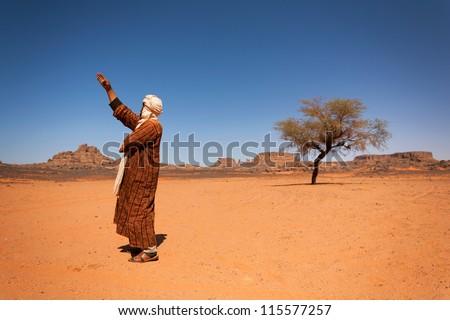 Tuareg in the Sahara Desert - stock photo