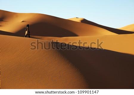 Tuareg on the desert - stock photo