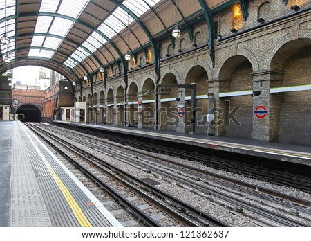 Tube station platform at central line in London - stock photo
