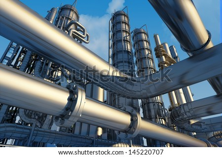 Tubes of factory on a background sky - stock photo