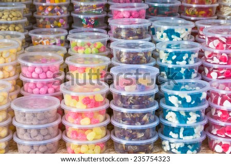 Tubs of sweets at a market stall - stock photo