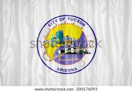 Tucson ,Arizona flag pattern with a peace on fabric texture,retro vintage style - stock photo