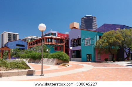 Tucson, Arizona - July 1, 2015: Tucson Skyline Showing La Placita Park and UniSource Energy Tower. Located near the St Augustine Cathedral , La Placita contains a gazebo that dates back to the 1800s. - stock photo