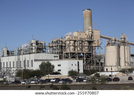 TUCSON, AZ - NOVEMBER 25, 2014: Parked cars and truck next to Tucson Electric Power plant on regular business day.  - stock photo