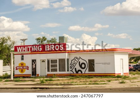 TUCUMCARI, NEW MEXICO - AUGUST 25, 2013:  Photo of a freshly painted former Whiting Bros. gas station on Route 66. - stock photo