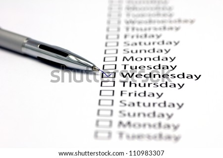 Tuesday checked in check box in a row of days of the week - stock photo