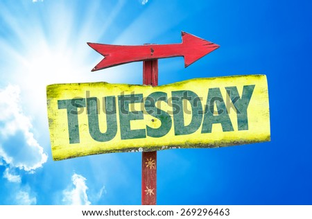 Tuesday sign with sky background - stock photo