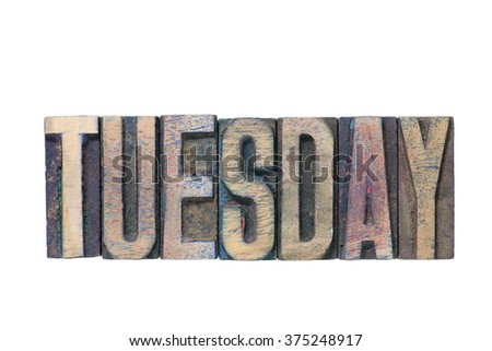 Tuesday word made from mixed wooden letterpress type isolated on white - stock photo