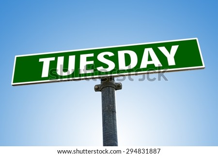 TUESDAY word on green road sign - stock photo