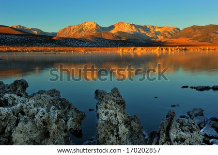 Tufa formations rise out of the water and ground at Mono Lake - stock photo