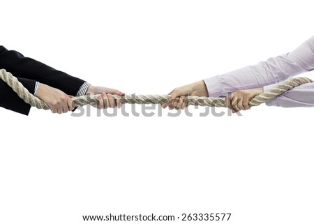Tug of war between women isolated on white - stock photo