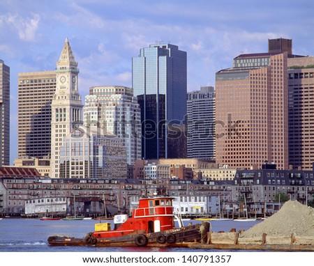 Tugboat and Boston Skyline, Massachusetts - stock photo