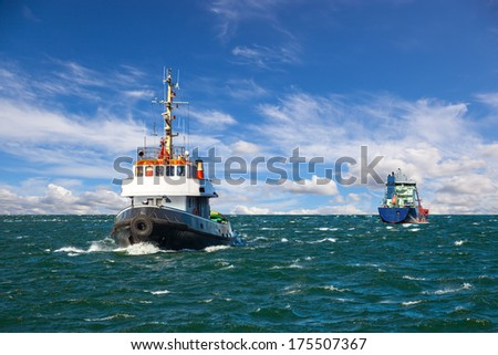 Tugboat and sea bulk carrier with pilot boats. - stock photo