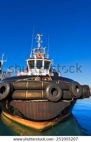 Tugboat in the Harbor. One tugboat docked in the harbor of La Spezia, Liguria, Italy - stock photo