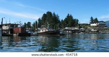 Tugboat in Wrangell Alaska Harbor Landscape - stock photo