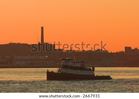 Tugboat on the East River at Dawn in New York City - stock photo