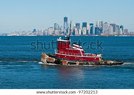 Tugboat on the Hudson River against the backdrop of Manhattan - stock photo