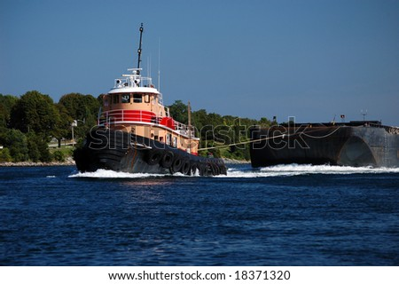Tugboat pulling barge in Cape Cod Canal - stock photo