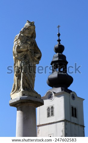 TUHELJ, CROATIA - SEPTEMBER 24: The Blessed Virgin Mary with baby Jesus in front of the parish church in Tuhelj, Croatia on September 24, 2014. - stock photo